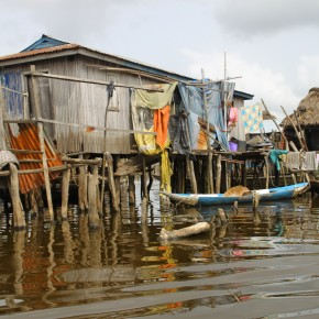 2011-04-07 Benin, Granvie Village - Lake Nokue - a village house with laundry and small boat - the village is on stilts, in the middle of the shallow lake established here in the past by people fleeing slavers