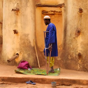 2009-1-19 Bobo Dioulasso, a one legged man saying prayers at the main mosque