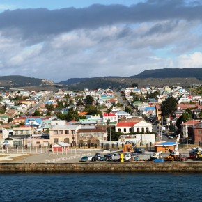 2010-12-27 Chile, Punta Arenas - view of the city from the ship with parallel streets, recently paved, extending back to the hills where there is gold mining going on