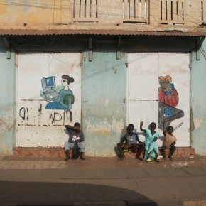 2011-04-15 Gambia, Banjul - children sitting in front of a run down building; still, Banjul is much more developed than its neighbors