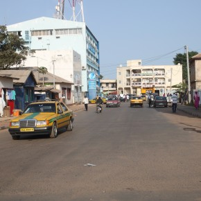 2011-04-15 Gambia, Banjul - city streets which seem pretty clear and relatively clean with large office buildings; Banjul is better off economically than Benin or Togo