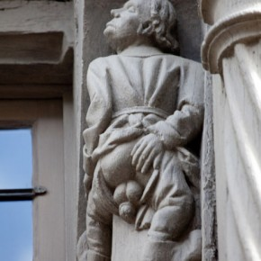 2010-05-05 Angers, France, sculpture of man mooning on the column of a Medieval building in the old part of the city