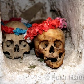 Chile, Parinacota Village 2008-11-05 - Adorned monks' skulls in the church in Parinacota Village in the Lauca National Park