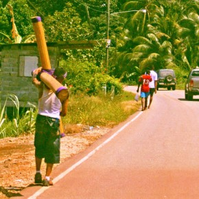 Panama, Portobelo 2008-10-20 - A penitent is walking to the town to pray to the Black Christ, carrying a huge cross. He had to walk several days and relied on donations for food and shelter (taken through a bus with tinted glass)