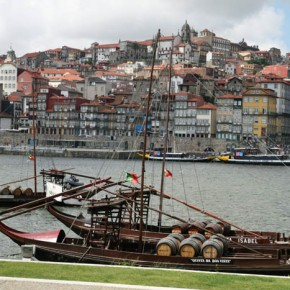 "2010-04-29 Oporto, Portugal looking across the Douro River at the old boats called ""rabelo"" which were used to bring the wine down from the uplands to the port area for aging"