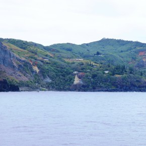 2011-02-14 Pitcairn Island - The view of the little settlement with houses and small gardens on the inside of the slope