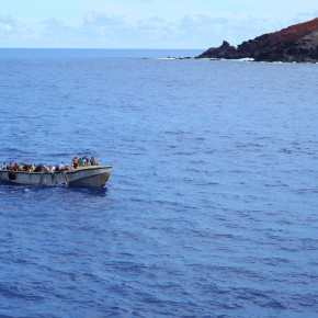 2011-02-14 Pitcairn Island - the islanders came out to meet us in their big shabby boat