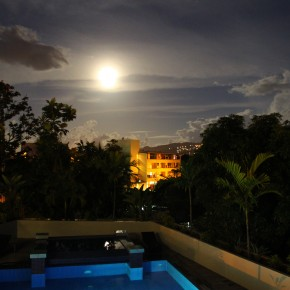 2011-02-18 Tahiti, Papete - Hotel Tahiti Nui; view of the full moon over the pool and city from my balcony at night