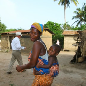 2011-04-08 Togo, Ewe Village, - mother with baby on her back in the village