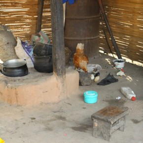 2011-04-08 Togo, Ewe Village - this is the typical West African kitchen. They cook meals in one large pot over a clay hearth on the floor. This family had a few chickens. Nothing is wasted and there is no trash anywhere.