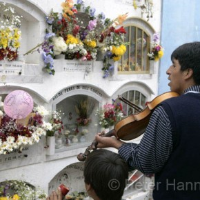 Peru, Callao 2008-11-01 - Day of the Dead celebrated in the public cemetery. wandering mistrels sing to the dead